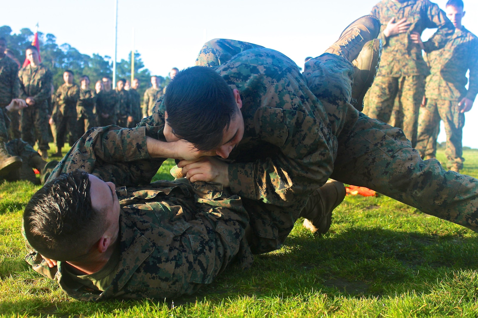 Marines from the Marine Corps Detachment practicing newly learned ground fighting techniques on one another during a grappling session.