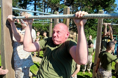Marines from the Marine Corps Detachment give all they've got while conducting pull-ups during a physical training session aboard the Presidio of Monterey.