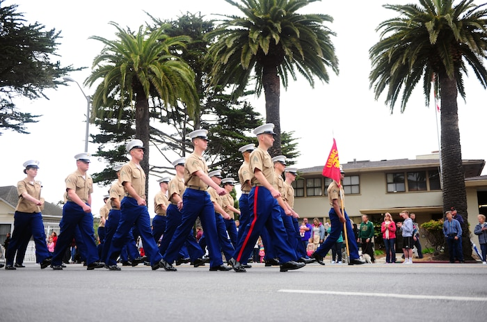 "PRESIDIO OF MONTEREY, Calif. -- The joint service color guard and service marching units from Defense Language Institute Foreign Language Center led the parade that kicked off Pacific Grove's 59th Annual Good Old Days Festival in downtown Pacific Grove, April 9. Free meals were provided to active duty military at the Pacific Grove Chamber of Commerce tent. The two-day event is the largest arts and craft festival in the county and drew an estimated 35,000 - 45,000 people to ""America's Last Hometown.""  -Steven L. Shepard, Presidio of Monterey Public Affairs."