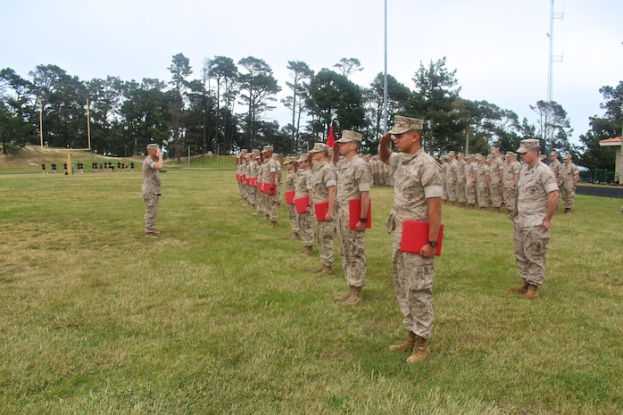 The Marine Corps Detachment's newest Lance Corporals and Privates First Class salute after being promoted during a promotion formation held on 1 May, 2016.
