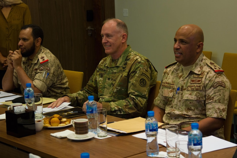 Col. Jeffrey D. Hawkins (center), a chaplain with U.S. Army Central, Kuwaiti Naval Brig. Gen. Mohammed Al-Thayeb (right), the director of Moral Guidance and Public Relations, prepare to kick off a question and answer session during a bilateral theater security cooperation seminar with members of the Kuwaiti military and council of ministers in Kuwait City, May, 2, 2016. The seminar was the start of discussions between the Kuwait military and USARCENT to partner and find ways to counter religious extremism. (U.S. Army photo by Sgt. Youtoy Martin, U.S. Army Central Public Affairs)