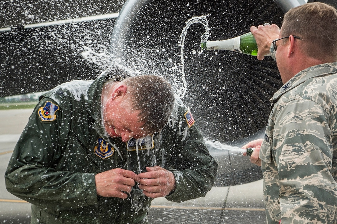 Air Force Col. Doug Schwartz gets a champagne shower upon landing from his last flight as commander of the 434th Air Refueling Wing at Grissom Air Reserve Base, Ind., May 13, 2016. Schwartz retired after 35 years of military service. Air Force photo by Tech. Sgt. Benjamin Mota
