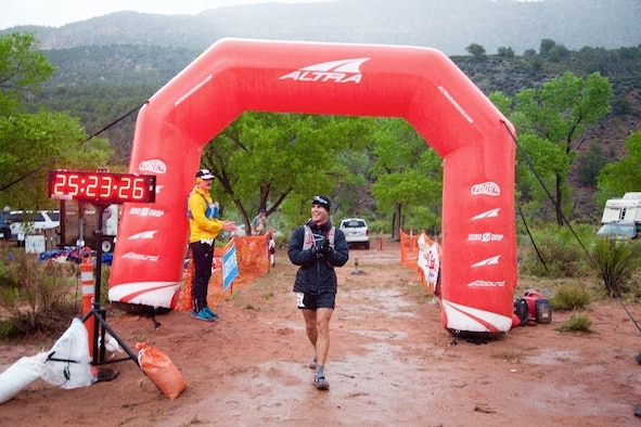 Maj. Peter Cossette, 944 Fighter Wing F-35 instructor pilot, passes the finish line after running the Zion 100 Mile Ultra Marathon along the outskirts of Zion National Park in Utah in just over 25 hours April 8-9. (Courtesy photo)