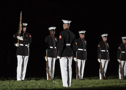 The Silent Drill Platoon performs during the Friday Evening Parade at Marine Barracks Washington, D.C., May 13, 2016. The guest of honor for the parade was the Honorable Frank Kendall, the Under Secretary of Defense for Acquisition, Technology and Logistics, and the hosting official was Gen. John M. Paxton Jr., assistant commandant of the Marine Corps. (Official Marine Corps photo by Cpl. Chi Nguyen/Released)