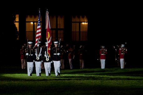 U.S. Marines with Marine Barracks Washington, D.C., march on the colors during the evening parade, May 13, 2016. Evening parades are held as a means of honoring senior officials, distinguished citizens and supporters of the Marine Corps. (U.S. Marine Corps photo by Pfc. Stephon L. McRae/ Released)