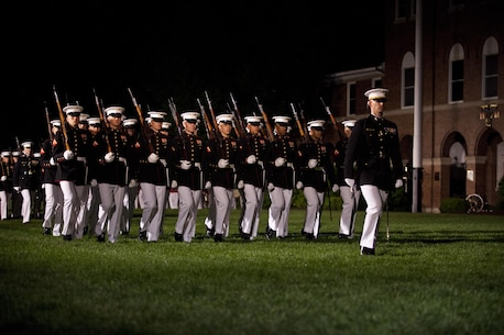 U.S. Marines with Marine Barracks Washington, D.C., conduct pass in review during the evening parade, May 13, 2016. Evening parades are held as a means of honoring senior officials, distinguished citizens and supporters of the Marine Corps. (U.S. Marine Corps photo by Pfc. Stephon L. McRae/ Released)