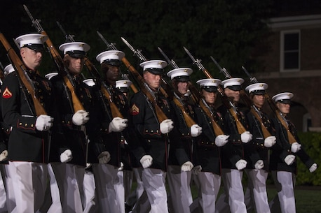 U.S. Marines with Marine Barracks Washington, D.C. conduct a pass in review during the evening parade at Marine Barracks Washington, D.C., May 13, 2016. Evening parades are held as a means of honoring senior officials, distinguished citizens and supporters of the Marine Corps. (U.S. Marine Corps photo by Cpl. Samantha K. Draughon/ Released)