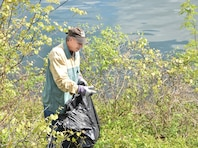 Senator John H. Eichelberger of Pennsylvania's 30th Senatorial District collects trash along Raystown Lake's shoreline during the Raystown Lake Cleanup Day, May 7, 2016.  130 volunteers came together to collect debris from remote areas of Raystown Lake's 110 miles of shoreline during the annual event.