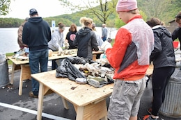 Volunteers hand sort debris for recyclables during the Raystown Lake Cleanup Day, May 7, 2016. Besides large amounts of plastic and glass, volunteers also collected tires, plywood, and even a computer monitor. 130 volunteers came together to collect debris from remote areas of Raystown Lake's 110 miles of shoreline during the annual event