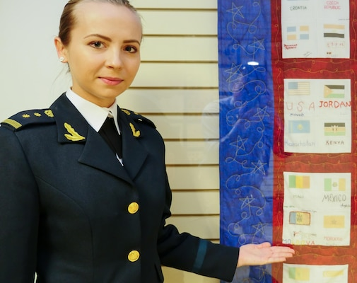 In 2015, when 2nd Lt. Nadejda Mocan of the Moldovan army was a student in the Public Affairs Course for International Students at the Defense Information School at Fort Meade, she and others toured the Pentagon. There, Mocan found the quilt that her mother and other international spouses made to express their condolences to the American people following the terror attacks of September 2001.