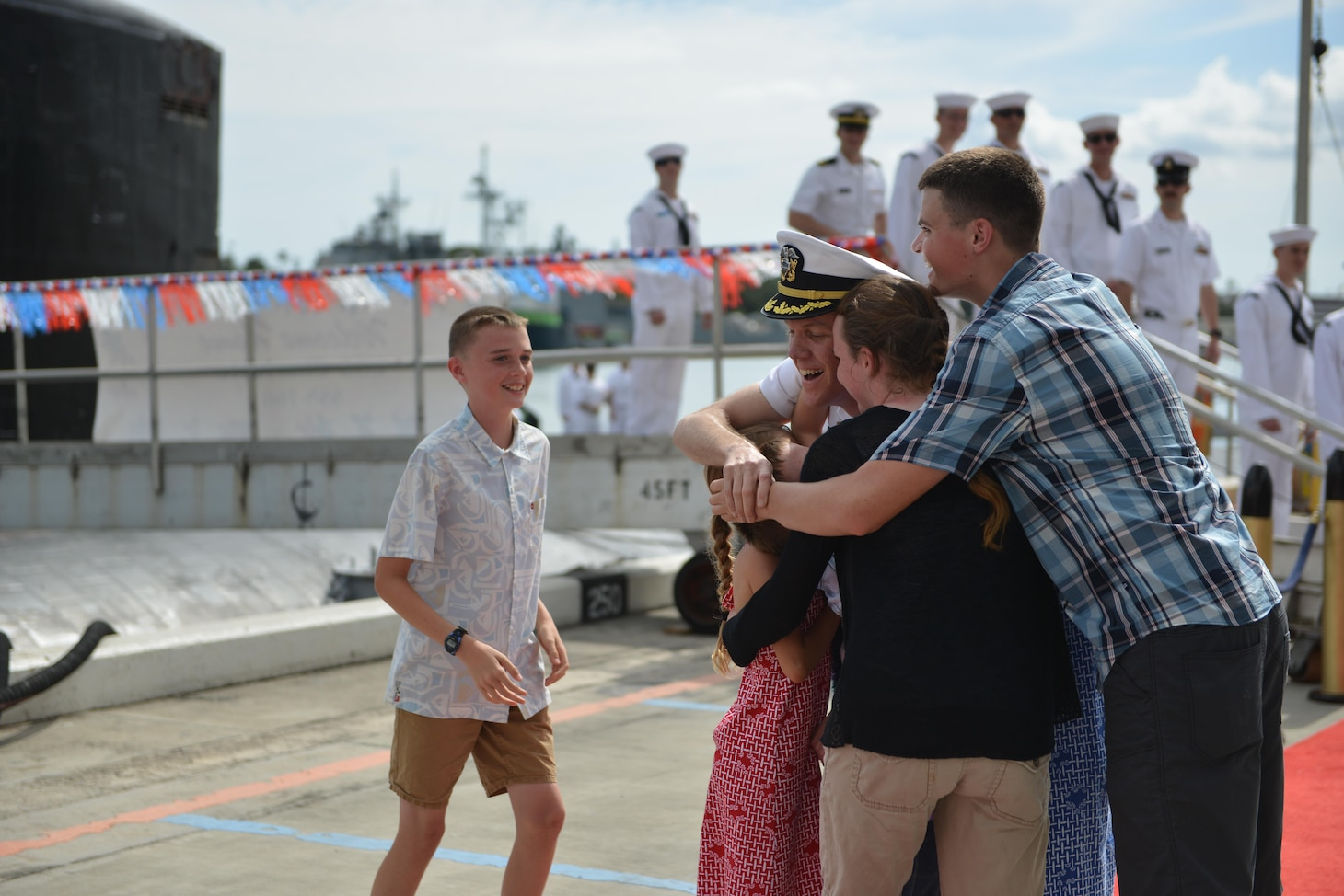 PEARL HARBOR Hawaii (May 13, 2016) Commander Andrew T. Miller, from Hilton Head, S.C., commanding officer of the Los Angeles-class fast-attack submarine USS Charlotte (SSN 766), is greeted by his children upon returning to Joint Base Pearl Harbor-Hickam following a six-month deployment to the Western Pacific. (U.S. Navy photo by Mass Communication Specialist 2nd Class Michael H. Lee/Released)