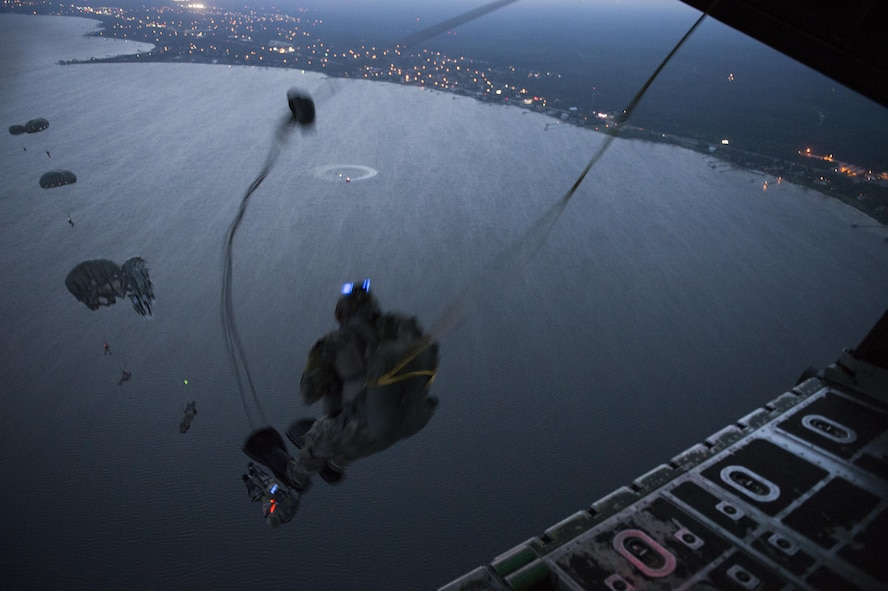 Special Tactics Airmen, assigned to the 24th Special Operations Wing, conduct static line jump operations from a U.S.Air Force MC-130H Combat Talon II assigned to the 15th Special Operations Squadron during Emerald Warrior, over a training range near Hurlburt Field, Fla., May 9, 2016. Emerald Warrior is a U.S. Special Operation Command-sponsored mission rehearsal exercise during which joint special operations forces train to respond to real and emerging worldwide threats. (U.S. Air Force photo by Tech. Sgt. Gregory Brook)