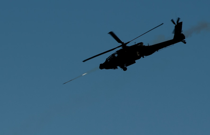 A U.S. Army AH-64 Apache D, shoots a missile over Eglin Range, Fla., during close air support training during Emerald Warrior 16, May 11, 2016. Emerald Warrior is a U.S. Special Operations Command-sponsored mission rehearsal exercise during which joint special operations forces train to respond to real and emerging worldwide threats. (U.S. Air Force photo by Senior Airman Trevor T. McBride)