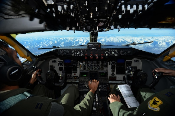 U.S. Air Force Captain's Karan Bansal, left, and Kyle McCullough, KC-135 Stratotanker pilots assigned to the 909th Air Refueling Squadron, Kadena Air Base, Japan, orient to the Joint Pacific Alaska Range Complex, May 12, 2016. The JPARC consists of all the land, air, sea, space and cyberspace used for military training in Alaska, providing unmatched opportunities for present and future Service, joint, interagency and multinational training and is comprised of approximately 65,000 square miles of available airspace, 2,490 square miles of land space with 1.5 million acres of maneuver land and 42,000 square nautical miles of sea and airspace in the Gulf of Alaska. (U.S. Air Force photo by Tech. Sgt. Steven R. Doty)