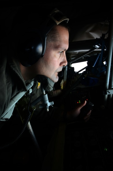U.S. Air Force Senior Master Sgt. Doug Palmisano, KC-135 Stratotanker boom operator assigned to the 909th Air Refueling Squadron, Kadena Air Base, Japan, conducts refueling operations May 12, 2016, over the Joint Pacific Alaska Range Complex. Boom operators on a KC-135 have the ability to pump thousands of pounds of fuel to any capable aircraft, thousands of feet above the ground, flying at 200 knots (230 miles per hour), all while only 47 feet from the receiving aircraft. (U.S. Air Force photo by Tech. Sgt. Steven R. Doty)