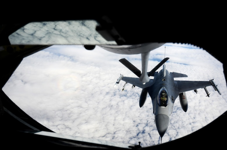 An F-16 Fighting Falcon aircraft with the 80th Fighter Squadron, Kunsan Air Base, Republic of Korea, lines up to receive fuel from a KC-135 Stratotanker from the 909th Air Refueling Squadron, Kadena Air Base, Japan, to begin an inflight refueling procedure May 12, 2016, inside the Joint Pacific Alaska Range Complex. In September of 1981, the 80th became the first unit stationed overseas to convert to the F-16 Fighting Falcon and on Jan. 31, 1992, the 80th Tactical Fighter Squadron was redesignated 80 FS. The 80th FS continues to support the United States Contingent in Korea with the same pride and excellence instilled in the squadron from the pilots of the past. (U.S. Air Force photo by Tech. Sgt. Steven R. Doty)