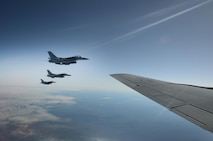 Three F-16 Fighting Falcon's with the 80th Fighter Squadron, Kunsan Air Base, Republic of Korea, fly alongside a KC-135 Stratotanker from the 909th Air Refueling Squadron, Kadena Air Base, Japan, May 12, 2016, inside the Joint Pacific Alaska Range Complex. The JPARC provides a realistic training environment and allows commanders to train for full spectrum engagements, ranging from individual skills to complex, large-scale joint engagements. (U.S. Air Force photo by Tech. Sgt. Steven R. Doty)