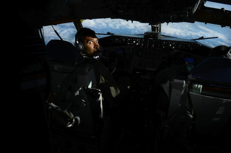 U.S. Air Force Capt. Karan Bansal, a KC-135 Stratotanker pilot assigned to the 909th Air Refueling Squadron, Kadena Air Base, Japan, directs his attention to an Indian Air Force airman, May 12, 2016, over the Joint Pacific Alaska Range Complex. As part of RED FLAG-Alaska 16-1, the 67th Fighter Squadron, 80th FS and the 909th ARS conducted an in-flight refueling exercise to demonstrate how tanker support can extend and prolong flight operations for U.S. and coalition aircraft. (U.S. Air Force photo by Tech. Sgt. Steven R. Doty)