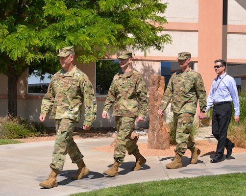 ALBUQUERQUE, N.M. – USACE South Pacific Division Deputy Commander Col. Eric McFadden leads Outgoing Albuquerque District Commander Lt. Col. Patrick Dagon, Incoming District Commander Lt. Col. James Booth, and acting Deputy District Engineer Mike Goodrich in the District's formal change of command ceremony, May 12, 2016.