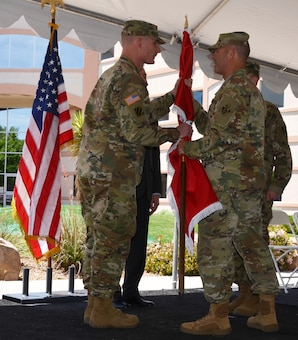 ALBUQUERQUE, N.M. – South Pacific Division Deputy Commander Col. Eric McFadden hands the U.S. Army Corps of Engineer flag to Incoming Albuquerque District Commander Lt. Col. James Booth during the District's formal change of command ceremony, May 12, 2016.  The ceremony symbolizes the transfer of command responsibility from one individual to another and is physically represented by the passing of the flag from the old commander to the new. Traditionally the next senior commander performs the transfer.