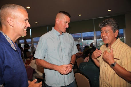 Col. Christopher Snyder, MCIPAC Chief of Staff, Col. David Odom, the commanding officer of Camp Schwab, and Munakastu Kayo, the Henoko Mayor talk during the Camp Schwab's Commander Social May 14. Local community leaders were invited to discuss the good relationships between their communities and Marine Corps Installations Pacific.