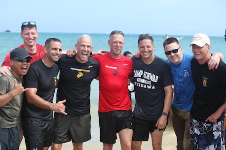 Col. David Odom, the commanding officer of Camp Schwab, participates in the Dragon Boat Races May 15 with his team. The races is a great way to experience the rich cultural history of Okinawa while having fun and making new friends.