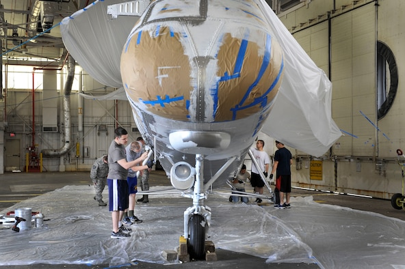 U.S. Air Force Airmen from the 314th Aircraft Maintenance Squadron paint a finishing coat on a Piasecki H-21 Workhorse helicopter May 12, 2015, at Little Rock Air Force Base, Ark. The 314th Airlift Wing received the helicopter from Kirtland Air Force Base and plan to display it in Heritage Park toward the end of June. (U.S. Air Force photo by Senior Airman Stephanie Serrano)