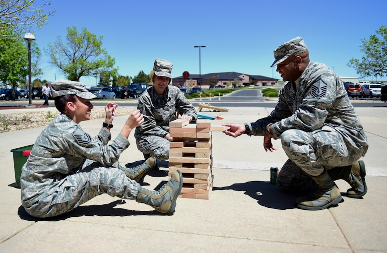 First sergeant symposium participants play Jenga during a break May 12, 2016, at the 140th Wing building on Buckley Air Force Base, Colo. The symposium allowed potential first sergeants four days of one-on-one time with current shirts who have been through difficult situations that make the job what it is and catch a small glimpse into what they could possibly have to handle. (U.S. Air Force photo by Airman 1st Class Gabrielle Spradling/Released)