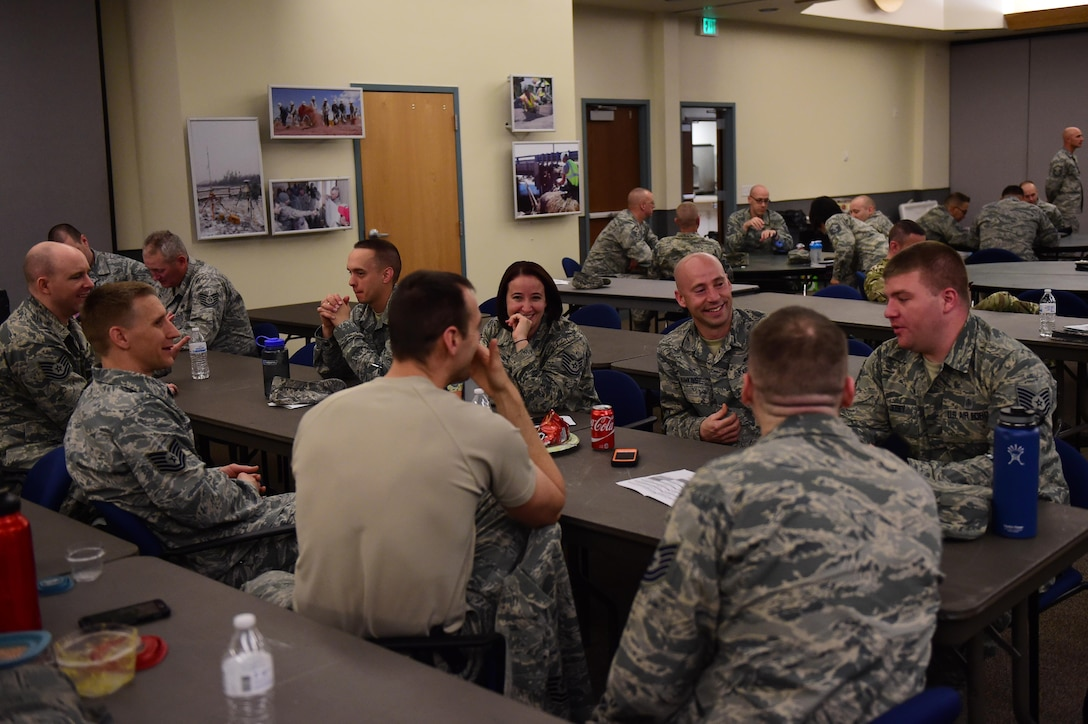 A group of participants talk during a break May 12, 2016, during the first sergeants symposium at the 140th Wing building on Buckley Air Force Base, Colo. The symposium provided an opportunity for technical sergeants and above to become familiar with what the job of a first sergeant is composed of. (U.S. Air Force photo by Airman 1st Class Gabrielle Spradling/Released)