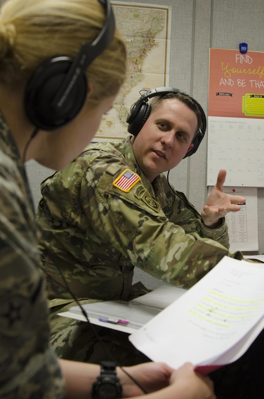 160506-N-HT014-074  FORT MEADE, Md. (May 6, 2016) Army Staff Sgt. Michael Sparks, a basic writing and announcing skills instructor at the Defense Information School on Fort Meade, critiques a student following a voice test at the school. Sparks was selected as the DINFOS Warrior of the Quarter for the first quarter of fiscal 2016.