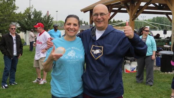 Gina Vasquez, Subsistence director of supplier operations and Rich Faso, Subsistence deputy director, pose after winning both the egg race and water balloon toss May 11 at a Spring Fling event. The Subsistence sensing team hosted the event.