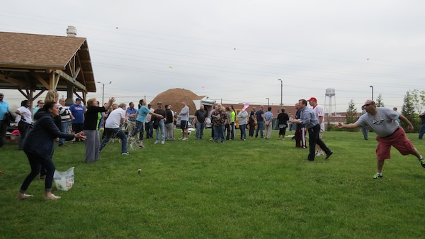 Subsistence employees compete in a water balloon toss during a Spring Fling event May 11 at DLA Troop Support in Philadelphia.