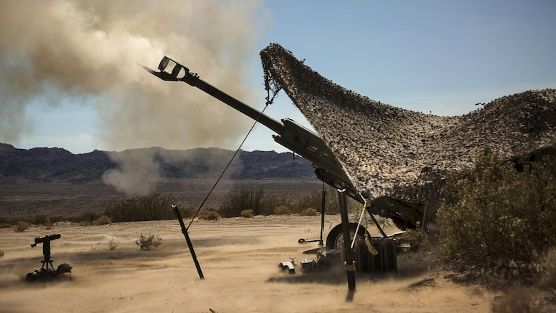 Marines with 3rd Battalion, 11th Marine Regiment, fire a 155mm M777A2 Lightweight Towed Howitzer in the Lead Mountain Training Area at Marine Corps Air Ground Combat Center Twentynine Palms, California, May 3, 2016. This firing exercise was focused on the ability of the M776 Chrome Tubes to resist the formation of hardened downbore residue when firing the M232A1 Propelling Charge 5H (top zone charges).