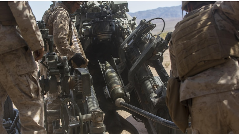 Marines with 3rd Battalion, 11th Marine Regiment, prepare to fire a 155mm M777A2 Lightweight Towed Howitzer in the Lead Mountain Training Area at Marine Corps Air Ground Combat Center Twentynine Palms, California, May 3, 2016. This firing exercise was focused on the ability of the M776 Chrome Tubes to resist the formation of hardened downbore residue when firing the M232A1 Propelling Charge 5H (top zone charges).