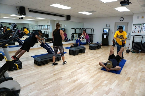 Employees work out at the new Tracy Fitness Center.