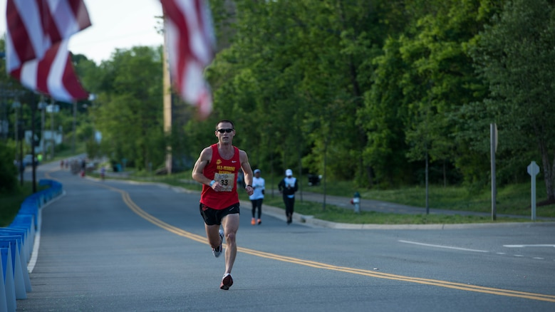 Capt. Calum Ramm a Marine Corps intelligence officer for the Marine Corps Cyber Space Warfare Group at Fort George G. Meade, Maryland, runs through the Blue Mile at the Marine Corps Historic Half Marathon in Fredericksburg, Virginia, May 15, 2016. Ramm finished third in the race despite recovering from several injuries and after completing seven marathons in seven continents in seven days.