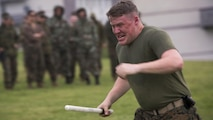 Cpl. Joseph A. Myers, a military policeman with 4th Law Enforcement Battalion, Force Headquarters Group, Marine Forces Reserve, participates in the oleoresin capsicum qualification course during exercise Platinum Wolf 16 at Peacekeeping Operations Training Center South Base, Serbia, May 11, 2016. Exercise Platinum Wolf 16 is designed to seamlessly integrate Reserve Marines with the active component while demonstrating interoperability with partner nations in the region.