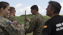Sgt. Maj. Sasha Toshevski, first sergeant of the Macedonian Special Forces Regiment, instructs a Bosnian solider on shotgun firing techniques while training in a non-lethal weapons class during exercise Platinum Wolf 2016 at Peacekeeping Operations Training  Center South Base in Bujanovac, Serbia, May 13, 2016. Seven countries including Bosnia, Bulgaria, Macedonia, Montenegro, Slovenia, Serbia, and the United States joined together to enhance their ability to work together and master the use on non-lethal weapons systems.