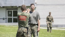 Sgt. Martin Belden, a non-lethal weapons instructor with 4th Law Enforcement Battalion, Force Headquarters Group, Marine Forces Reserve, sprays a Bosnian soldier with oleoresin capsicum, during a non-lethal weapons course at exercise Platinum Wolf 2016 aboard Peacekeeping Operations Training Center South Base in Bujanovac, Serbia, May 13, 2016. Seven countries including Bosnia, Bulgaria, Macedonia, Montenegro, Slovenia, Serbia, and the United States joined together to practice peacekeeping operations and improve their abilities to work together.