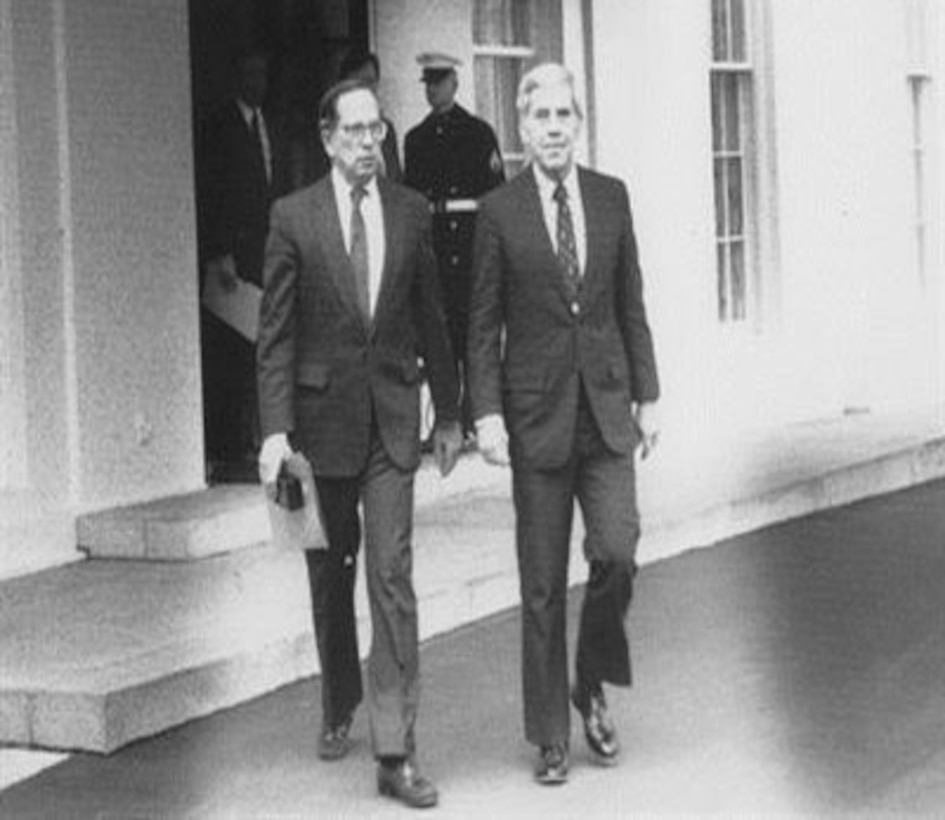 Then-U.S. Sens. Sam Nunn, left, and Richard Lugar leave the White House in 1991 after briefing then-President George H.W. Bush on their cooperative threat reduction legislation.