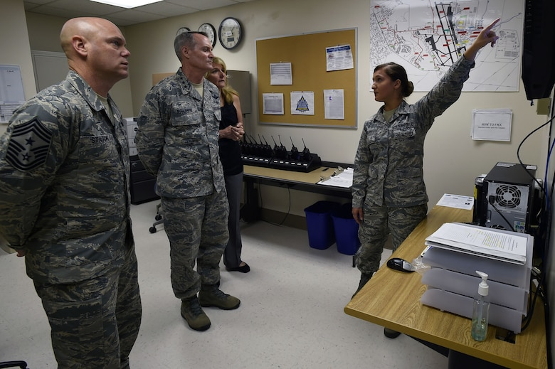 Senior Airman Arlinda Haliti briefs Lt. Gen. Darryl Roberson, commander, Air Education and Training Command, his wife, Cheryl Roberson, and AETC Command Chief Master Sgt. David Staton, on the En-Route Patient Staging System facility and mission May 11 at the Wilford Hall Ambulatory Surgical Center, Joint Base San Antonio-Lackland.  Roberson and Staton visited the WHASC May11, meeting with 59th Medical Wing senior leaders and Airmen to learn more about the wing's mission of developing warrior medics through patient-centered health care and continuous improvement. Haliti is an aerospace medical technician with the 559th Aerospace Medicine Squadron. (U.S. Air Force photo/Staff Sgt. Jason Huddleston)