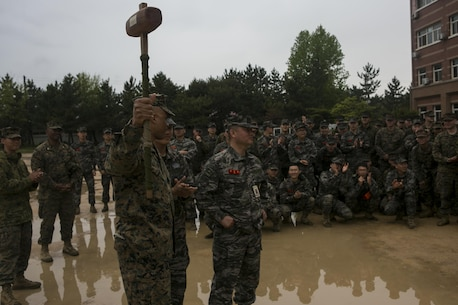 "U.S. Marines and Sailors with Alpha Company, 1st Battalion, 3rd Marine Regiment, also known as ""The Lava Dogs"", present a gift to Republic of Korea (ROK) marines during the Korean Marine Exchange Program (KMEP) in South Korea, April 13, 2016. KMEP is a program designed to increase interoperability and camaraderie between U.S. Marines and ROK marines. The alliance between America and the Republic of Korea has grown ever stronger based upon the shared interests and common values of both nations. (U.S. Marine Corps photo by MCIPAC Combat Camera Lance Cpl. Sean M. Evans/ Released)"