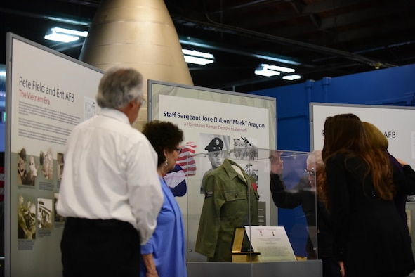 Members of Staff Sgt. Jose Aragon's family view Peterson Air and Space Museum's new exhibit on the Vietnam War on May 16, 2016. Staff Sgt. Aragon, a Colorado native, was killed during the Vietnam War and posthumously awarded the Bronze Star for his actions while serving at Bien Hoa Air Base, Vietnam. (U.S. Air Force photo by Staff Sgt. Amber Grimm)