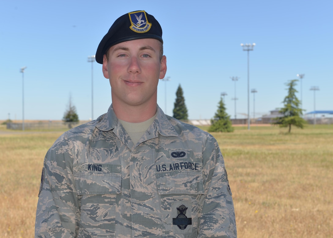Senior Airman Christopher King, 9th Security Forces Squadron installation entry controller, poses for photo outside the 9SFS building at Beale Air Force Base, California. (U.S. Air Force photo by Senior Airman Benjamin Bugenig)