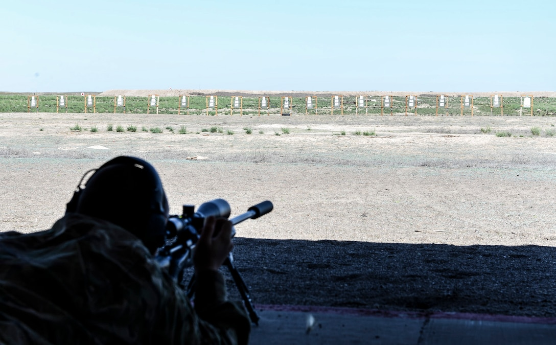 Justin Scott, Canyon County sheriff office detective, fires at a target during a sniper training exercise April 20, 2016, at Mountain Home Air Force Base, Idaho. Mountain Home AFB's range gave the officers an opportunity to shoot at long distances.  (U.S. Air Force photo by Airman 1st Class Chester Mientkiewicz/Released)