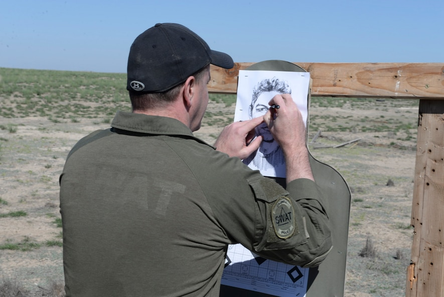 Scott Crupper, Caldwell police department officer, checks his target after firing April 20, 2016, at Mountain Home Air Force Base, Idaho. The officers were taught ways to make corrections to their weapon sights and techniques during long distance shots based on where they hit the target. (U.S. Air Force photo by Airman 1st Class Chester Mientkiewicz/Released)