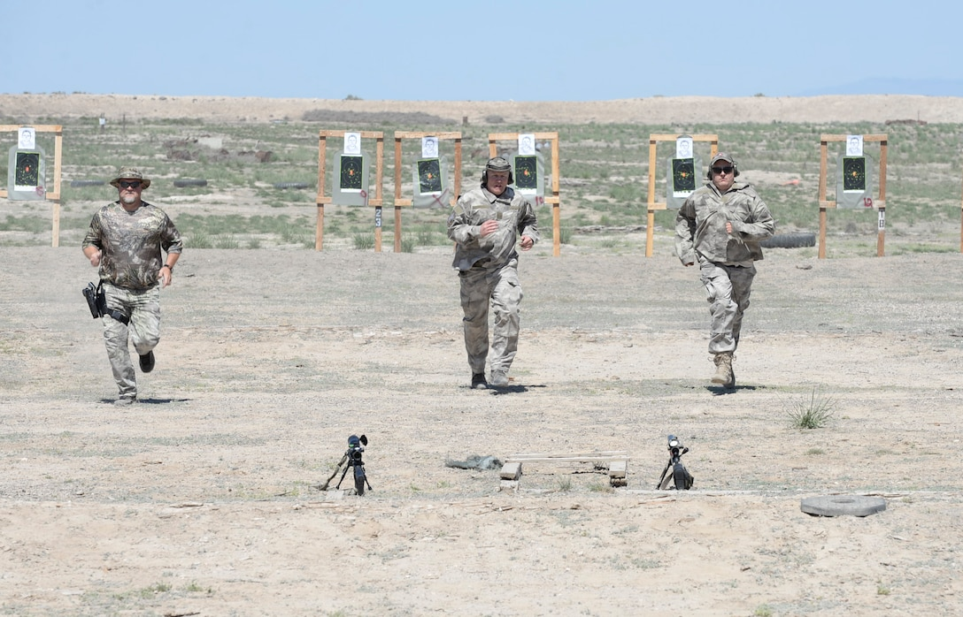 Local law enforcement officials run back to their weapons during a sniper training exercise April 20, 2016, at Mountain Home Air Force Base, Idaho. During this exercise the officers ran to their targets and then back to their weapons to fire in a limited amount of time to simulate the urgency of a real, life event. (U.S. Air Force photo by Airman 1st Class Chester Mientkiewicz/Released)
