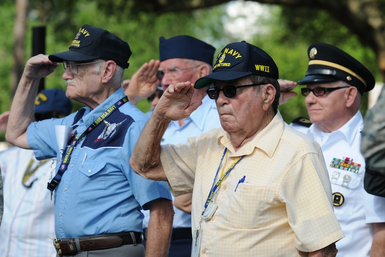 U.S. Navy retired Chief Petty Officer Frederick Petersen and fellow members from the Armed Forces Retirement Home render a salute during the playing of taps at the Lt. Samuel Reeves Keesler, Jr. Memorial Retreat Ceremony May 13, 2016, Keesler Air Force Base, Miss. The event was held in honor of Lt. Keesler's date of entry into the Army Air Service 99 years ago. The retreat ceremony is part of a year-long celebration of Lt. Keesler, a Mississippi native and WORLD WAR I hero, and the 75th anniversary of the opening of the base. (U.S. Air Force photo by Kemberly Groue)