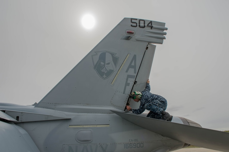 U.S. Navy Aviation Machinist Mate 2nd Class Joseph Neely, from VAQ-137, Naval Air Station Whidbey Island, Washington, inspects rivets and panels on an EA-18G Growler electronic attack aircraft prior to a sortie May 9, 2016 during RED-FLAG-Alaska (RF-A) 16-1 at Eielson Air Force Base, Alaska. The aircraft logged more than 500 tactical flying hours during RF-A 16-1, which requires maintainers to work around the clock. (U.S. Air Force photo by Staff Sgt. Shawn Nickel/Released)
