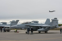 U.S. Navy Sailors from VAQ-137, Naval Air Station Whidbey Island, Washington, watch over an EA-18G Growler aircraft while other  May 9, 2016 during RED-FLAG-Alaska 16-1 at Eielson Air Force Base, Alaska. More than 40 Sailors from VAQ-137 are augmenting RF-A, a Pacific Air Forces command directed field training exercise for U.S. and allied forces, to provide joint offensive counter-air, interdiction, close air support and large force employment training in a simulated combat environment. (U.S. Air Force photo by Staff Sgt. Shawn Nickel/Released)